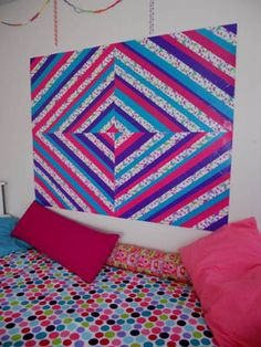DIY duct tape wall art: This duct tape wall art on EmmiGrace and Me is so striking, no? It functions as an attractive decoration on its own, or it can be used as a board for kids to tape up their own creations without damaging the wall. Brilliant!