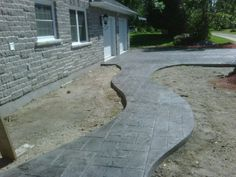 walkway and patio ideas | stamped concrete walkway to laneway