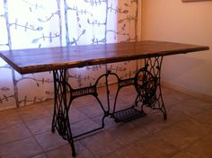 Reclaimed repurposed furniture table. Cast iron and wood.