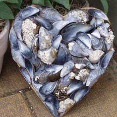 I could buy this mussel shell heart, or I could use the mussel shells I have in a bucket in my garden shed that I've been saving for just the right project.  I'm thinking this may be the right project!