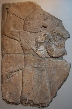 Gypsum wall panel relief: depicting the protective spirit, the Ugallu or 'great lion' with a dagger. Formed of two fragments joined.Neo-Assyrian, 700BC-692BC.