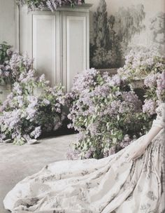 deprincessed: Among the freshly gathered lilacs, Guinevere wears Alexander McQueen's fairytale couture gown and drifts in to a reverie. Guinevere Van Seenus in 'England's Dreaming' shot by Tim Walker for Vogue UK August 2006