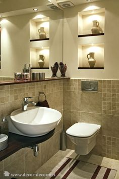 I like the toilet and the sink.  The nooks are a good idea for storage if they were larger