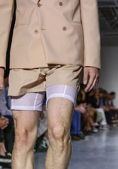 Wool double breasted sport jacket with poplin shorts and mesh boxer brief from the men's Spring 2015 Calvin Klein Collection.