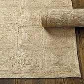 The subtle, geometric pattern of the Bali Jute Rug is created by joining diamonds of tightly coiled jute braids. Depending on your viewing angle, the pattern can look like diamonds or squares. Surprisingly soft, it's hand woven of natural 100% jute. Use of a rug pad is recommended.Bali Jute Rug features:Fully reversibleSwatches availableSizes are approximateImported