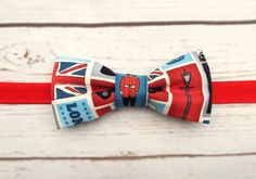 **Ready to ship**  Only 2 remain of this British London theme fabric - a cool print with known British Icons 100% cotton  The bow tie is fully stitched by machine and fastens with a piece of velcro stitched on to the contrast red neckband. Slightly adjustable due to the 2 inch wide velcro. The velcro does not go above the neckband and the scratchy side faces away from the neck as well  Bow size is 2 x 4 inches approx  See other bow ties here…