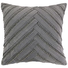 Pleat grey decorative pillow goes pleasantly with the grey sofa and it's embellished with small beads that render as a very elegant feature.