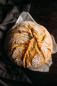 Easy Crusty Dutch Oven Bread - This easy French bread recipe is sure to be a hit! Ready in just a few hours - no overnight rising necessary. Baked in a dutch oven for a crispy crust on the outside and soft, airy homemade bread on the inside! Vegetarian.