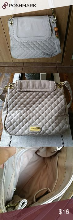 Big Buddha Carlton Crossbody w/ FREE Wallet ***price reduced!*** Grayish/taupe quilt pattern with tassel, strap adjusts - gently used, tiny bit of staining inside (see pic 4) but in really great shape!!! Will throw in a free wallet! Plus EVERY PURCHASE COMES WITH A FREE ACCESSORY! 10-1/2 H x approx 11-1/2 W Big Buddha Bags Crossbody Bags