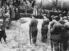 Amiens, France May 22, 1918. British troops reverently stand by as Manfred von Richthofen, the German ace pilot know as the Red Baron is buried. He was shot down on the Western Front, and his body fell behind the British lines. He was buried with full military honors.