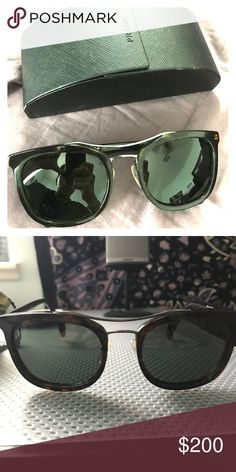Prada Sunglasses PR 17Q sunglasses for sale in excellent condition. Dark lenses with tortoise frame and metal bridge. Classic and sophisticated with a touch of eccentricity. Non polarized. Prada Accessories Sunglasses