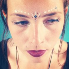 Festival face paint, sequins and bindi