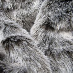 Winter Wolf - dark chocolate 25mm pile synthetic faux fur fabric with frosted tip. $8.00, via Etsy.