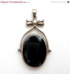 Sterling Silver Reversible Pendant Mother Of Pearl Black Onyx Vintage  Sterling silver slide pendant that is reversible.  Mother of pearl on