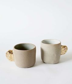 Enjoy your favourite brew in one of Bridget Bodenham's signature style ceramic mugs. Hand formed, featuring a 'raw' finish stoneware ex...