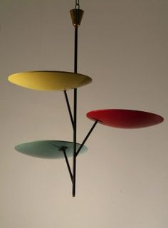 Stilnovo, Milan. Ceiling light, designed in the 1950s. H. 84 cm; Dia. 76 cm. Metal, painted black, aluminium sheet, painted red, yellow and green.