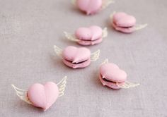 French Macaroon heart cookies with chocolate wings