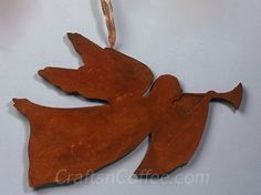 Antique Angel Craft - you'd never know it's cut from a sheet of Styrofoam and painted with a faux rust finish.