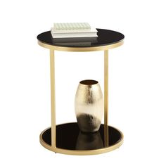 Round end table with a golden metal frame, black glass top, and matching bottom shelf. Product: End tableConstructi...