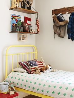 yellow metal framed bed