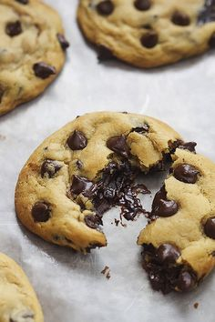 The BEST soft and chewy BIG chocolate chip cookies stuffed with gooey hot fudge sauce!