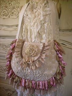 Purse.  Very pretty but would remove the flower and add something brass or gold like a large pin.  CTH
