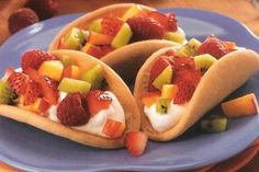 "make sugar cookies shaped into ""hard shell"" taco.  fill with fruit dip and fresh fruit for individual ""fruit tacos"".....a cute twist on ""fruit pizzas"".  i love this idea!!"