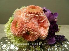 Pretty purple and coral wedding bouquet.