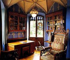 "A very pretty goth inspired office! I love the ""blurple"" walls!"