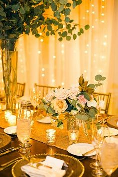 boho glam wedding reception with twinkle light backdrop - photo by Cyn Kain Photography