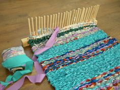 Peg loom weaving. This is interesting. check out thru website.
