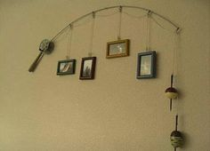 This is so smart! Use an old fishing reel and rod to hang those pics :)