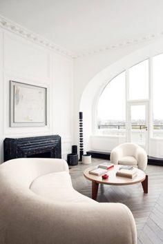 white round sofa, herringbone wood floors, crown molding // living rooms