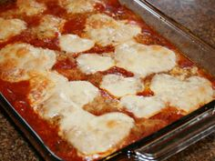 Chicken parmesan with cheese cut in heart shapes for Valentine's Day dinner.