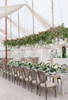 Who you have ceilings this high, you have plenty of room to hang a wooden trellis installation, like this one that's decorated with a variety of pretty, textured greens.