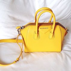 Sigh. One day I will own a yellow Givenchy handbag