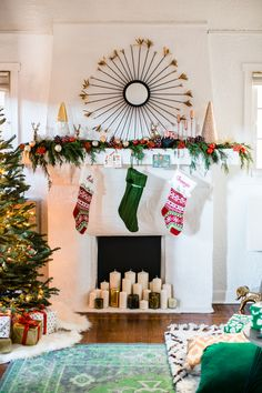 """HOW TO: Style a perfect holiday mantle.  1. Start with a garland of cedar. Smells great and adds life. 2. Pick out decor items that differ in height. 4. Place tall items on the outer edge and work in your different sized items from there creating a """"skyline."""" 5. If you need to add height to an item stack some books underneath! 6. Add small extra pieces like ornaments and pinecones. 7. If your fireplace doesn't allow for logs, add various sizes of candles to add a festive touch!"""