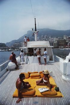 Scotti's Yacht (©️️ Slim Aarons): Guests on board Italian Count Hannibal Scotti's yacht, 'Scotland Cay', Monte Carlo harbour, Monaco.