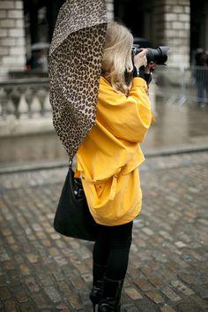 yellow raincoat and leopard print umbrella