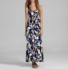 From The A Collection, this women's dress features:    allover ultramarine/black multi washed iris print  scoopneck  sleeveless tank styling  approx. 53″ long (from high point shoulder)  polyester/spandex; machine wash