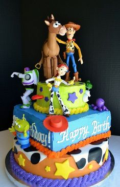 Would love to get this for Coltins Birthday if he still loves Toy Story.Toy Story Birthday Cake: Tiered yellow cakes filled with chocolate mousse, frosted in buttercream and topped with figurines. For a very special occasion! Festa Toy Story, Toy Story Party, Fancy Cakes, Cute Cakes, Bolos Toy Story, Beautiful Cakes, Amazing Cakes, Toy Story Birthday Cake, Birthday Cakes
