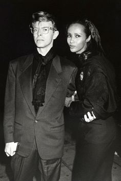1990-Bowie+Iman in a suit and glasses at Eduard Nakahamkim Fine Arts Gallery Benefiting the American Cancer Society