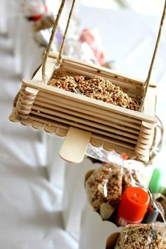Popsicle sticks bird feeder. Note that the perch in the center is made of a tongue depressor, available in pharmacies or directly from your doctor …