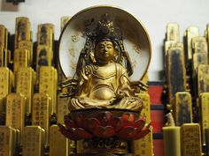 Mortuary tablets and a small Buddha at Eiheiji Temple. Photograph by Hiroshi Termy Hosokawa