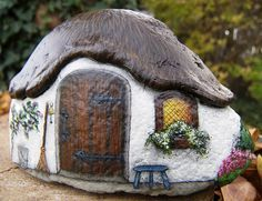 painted rocks fairy house