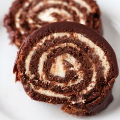Chocolate Swiss Roll Cake is the ultimate decadent gourmet dessert that looks ridiculously complicated but is totally doable. It's SO amazingly scrumptious.