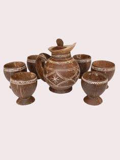 A tea-pot with a set of 6 glasses, crafted from pure coconut shells, is an assertion of the artist's ingenuity and skill.  Besides being attractive, the use of the tea pot and glasses with bring delight and joy to the user, the unusual and creative shapes are sure to invite admiration and praise from all.