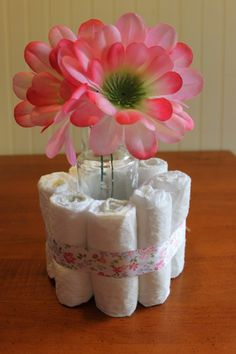 DIY Baby Shower Centerpieces Using Diapers @Andrea Niedermier do you still have those small vases from your wedding?