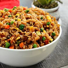 Easy Fried Rice Recipe Side Dishes with butter, eggs, frozen peas and carrots, minced garlic, salt, pepper, cooked rice, green onions, soy sauce, oyster sauce, toasted sesame oil