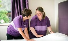 Claire Brunt, 24, learns how to make beds in a Premier Inn at Shropshire's Derwen College with her tutor Yvonne Daniel